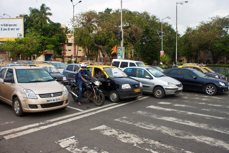 traffic jams: MUMBAI - SEPTEMBER 6. Daily traffic jams in Mumbai on September 6, 2011. As on 2008 there are 507,408 cars and 58,813 taxis in Mumbai