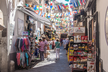 sorrento: SORRENTO, ITALY - JUNE 29, 2014: People on a street in Sorrento. Sorrento is a small town in Campania, southern Italy. Editorial
