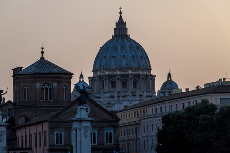 copula: St. Peters Basilica copula and other buildings in Rome, Italy during sunset