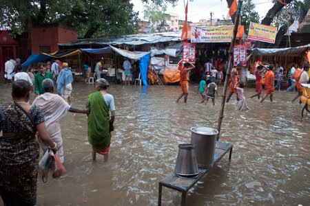 VARANASI, INDIA - AUGUST 11: People at flooded market on August 11, 2011 in Varanasi, Uttar Pradesh, India. India's monsoon rains were 14 percent above normal in the week to Aug. 10, 2011. Editorial