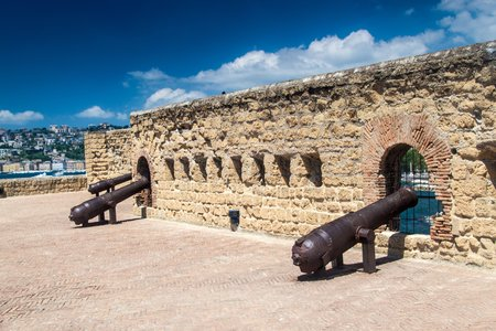 offensive: Cannons at Castel dellOvo (Egg Castle), a medieval fortress in the bay of Naples, Italy.
