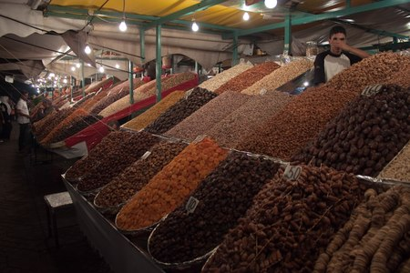 suq: MARRAKESH, MOROCCO - AUG 7: Stalls with fruit at the Jema el Fna Square in Marrakesh on Aug 7, 2010 in Marrakesh, Morocco. The square is part of the UNESCO World Heritage.