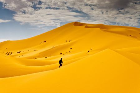 Man lost in desert dunes photo