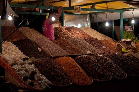 suq: MARRAKESH, MOROCCO - AUG 7: Stalls with fruit at the Jema el Fna Square in Marrakesh on Aug 7, 2010 in Marrakesh, Morocco.   Editorial