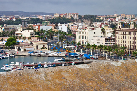 bordering: MELILLA, SPAIN - JULY 25: View of Melilla city on July 25, 2010 in Melilla, Spain.The city has a population of 81,188 inhabitants and it is the bordering region of Rif (Morocco). Stock Photo