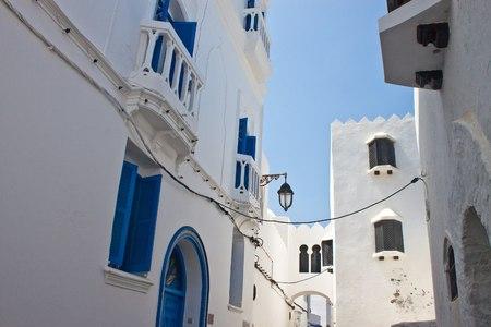 Narrow street in medina of Asilah, Morocco