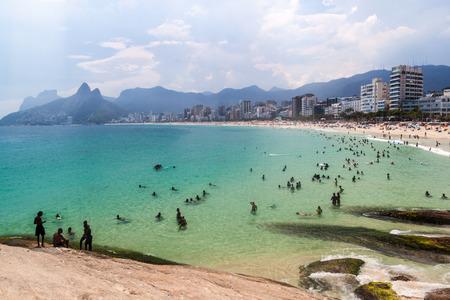 RIO DE JANEIRO, BRAZIL - JANUARY 27, 2015: People enjoy the famous beach Ipanema in Rio de Janeiro.