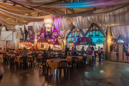 argentina dance: VILLA GENERAL BELGRANO, ARGENTINA - APR 3, 2015: German style beer hall in Villa General Belgrano, Argentina. Village now serves as a Germany styled tourist sttraction.