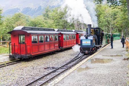 tierra: TIERRA DEL FUEGO, ARGENTINA - MARCH 7, 2015: Tourist steam train in National Park Tierra del Fuego, Argentina Editorial