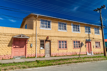 excitation: ACHAO, CHILE - MARCH 21, 2015: View of houses lining streets of Achao village, Quinchao island, Chile