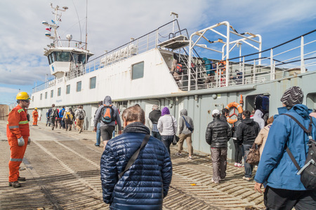 magallanes: MAGELLAN STRAIT - MARCH 3, 2015: People on a ferry over Magellan strait between Tierra del Fuego island and mainland, Chile