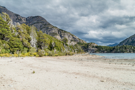 huapi: Beach at Bahia Lopez bay in Nahuel Huapi lake near Bariloche, Argentina Stock Photo