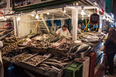 city fish market sign: SANTIAGO, CHILE - MARCH 28, 2015: Fresh fish and seafood on Mercado Central market in the center of Santiago, Chile