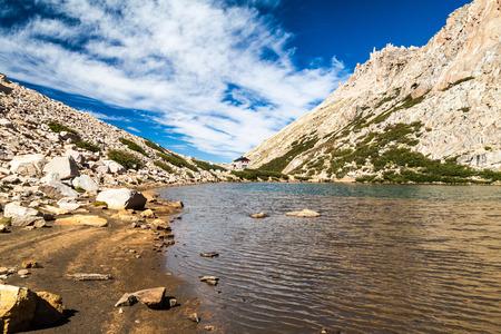 lake argentina: Mountain hut Refugio Frey and Laguna Toncek lake near Bariloche, Argentina Stock Photo