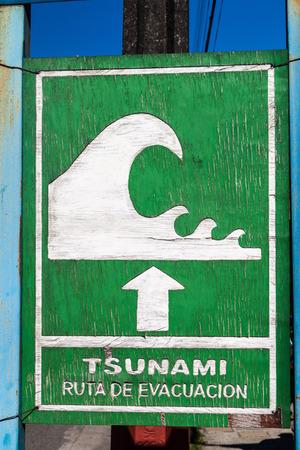 flood area sign: Tsunami Hazard Zone Sign in Curaco de Velez village, Chile
