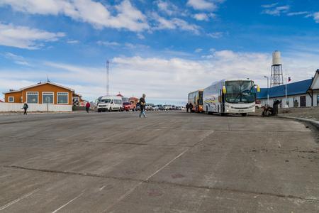 strait of magellan: MAGELLAN STRAIT - MARCH 3, 2015: Vehicles wait for a ferry over Magellan strait between Tierra del Fuego island and mainland, Chile