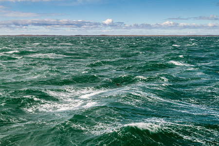 the mainland: Waves of Magellan strait between Tierra del Fuego island and the mainland, Patagonia, Chile Stock Photo