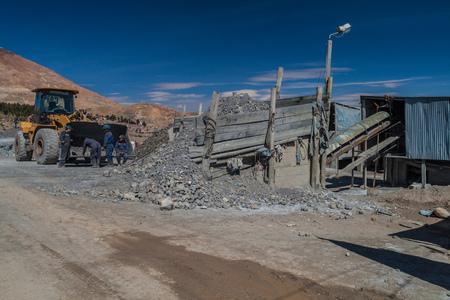 refinement: POTOSI, BOLIVIA - APRIL 20, 2015:  Workers at the ore processing facility in Potosi, Bolivia. Editorial