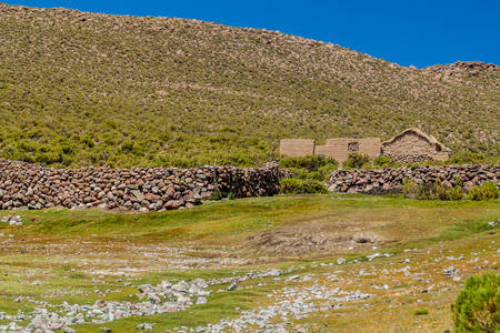 bolivian: Adobe house in the wilderness of bolivian Altiplano Stock Photo