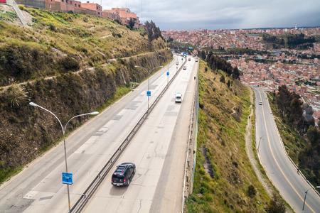 highway traffic: LA PAZ, BOLIVIA - APRIL 23, 2015: Autopista (highway) between La Paz and El Alto, Bolivia Editorial