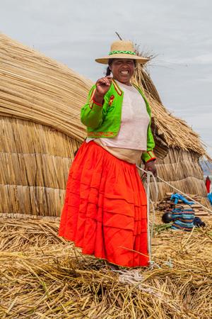 quechua indian: TITICACA, PERU - MAY 15, 2015: Inhabitant of one of Uros floating islands, Titicaca lake, Peru