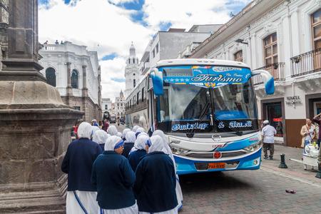 la compania: QUITO, ECUADOR - JUNE 24, 2015: Group of nuns in front of  La Compania de Jesus church in old town of Quito, Ecuador