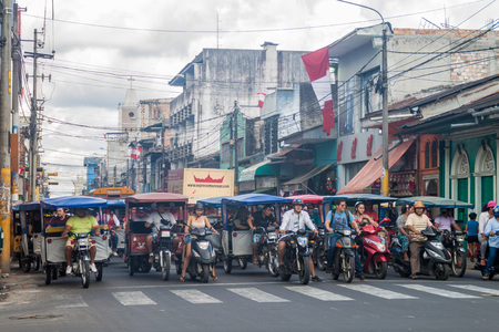 mototaxi: IQUITOS, PERU - JUNE 18, 2015: View of a street full of mototaxis in Iquitos, Peru Editorial