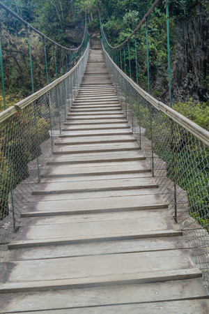 rickety: Suspension bridges leading to the viewpoint on Pailon del Diablo (Devils Cauldron) waterfall near Banos town, Ecuador