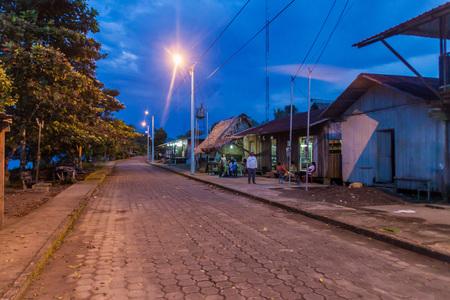 nuevo: NUEVO ROCAFUERTE, ECUADOR - JULY 8, 2015: Main street in Nuevo Rocafuerte village, Ecuador