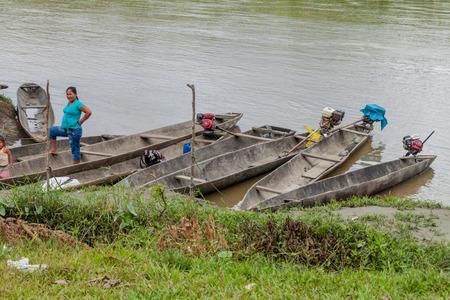 dugout: PANTOJA, PERU - JULY 9, 2015: Villagers on a dugout canoe called Peke Peke on a river Napo, Peru Editorial