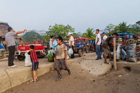autorick: MAZAN, PERU - JUNE 17, 2015: Cargo transport near Amazon river in Mazan town, Peru
