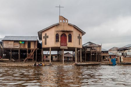 deprived: IQUITOS, PERU - JULY 18, 2015: View of a church in partially floating shantytown in Belen neigbohood of Iquitos, Peru. Editorial