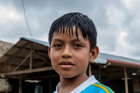 impoverished: PANTOJA, PERU - JULY 10, 2015: Child living in small village Napo in amazonian jungle, Peru