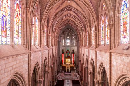 vow: QUITO, ECUADOR - JUNE 24, 2015: Interior of the Basilica of the National Vow in Quito, Ecuador
