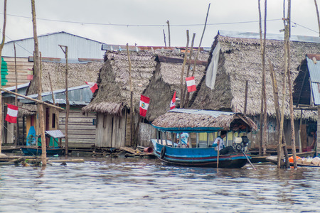 depress: IQUITOS, PERU - JULY 18, 2015: View of floating shantytown in Belen neigbohood of Iquitos, Peru.