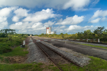 european integration: Gate, transport tracks and The final assembly building for Ariane 5 space rocket at Centre Spatial Guyanais (Guiana Space Centre) in Kourou, French Guiana
