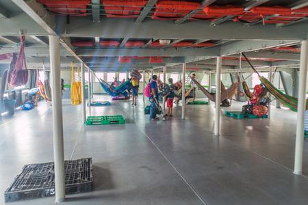TABATINGA, BRAZIL - JUNE 22, 2015: Passengers of hammock deck board the boat Diamante which plies river Amazon between Tabatinga and Manaus, Brazil.