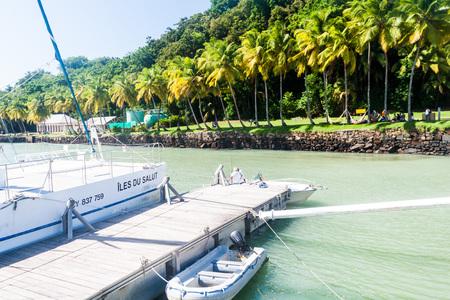 salut: ILE ROYALE, FRENCH GUIANA - AUGUST 2, 2015: Pier at Ile Royale, one of the islands of Iles du Salut (Islands of Salvation) in French Guiana.