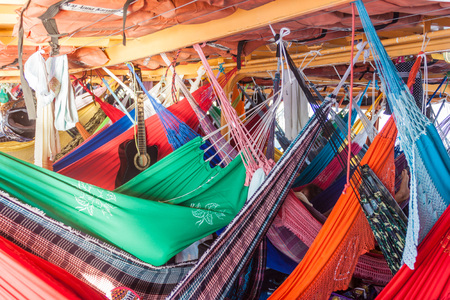 plies: AMAZON, BRAZIL - JUNE 27, 2015: Hammock deck at the boat Anna Karoline II which plies river Amazon between Santarem and Manaus, Brazil.