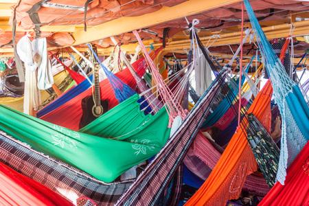 plies: AMAZON, BRAZIL - JUNE 27, 2015: Hammock deck at the boat Anna Karoline II which plies river Amazon between Santarem and Manaus, Brazil.
