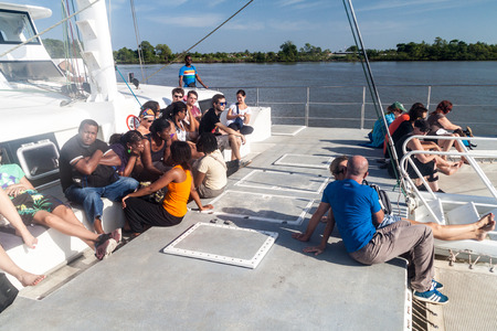 the french way: KOUROU, FRENCH GUIANA - AUGUST 2, 2015: Tourists aboard modern catamaran on their way to Iles du Salut (Islands of Salvation) in French Guiana. Editorial