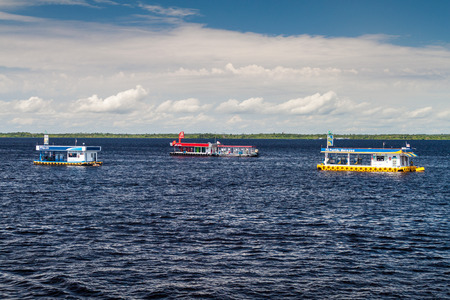 MANAUS, BRAZIL - JULY 27, 2015: Floating gas stations at Manaus port, Brazil