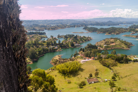 antioquia: Steep Piedra del Penol rock, Colombia. Guatape dam lake in the background.