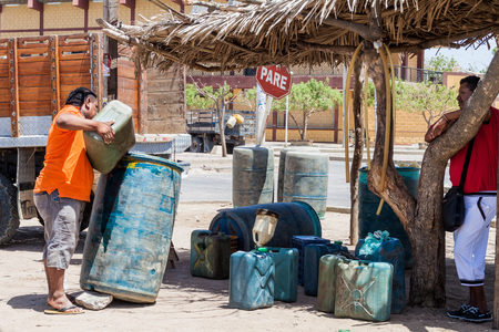 illegality: URIBIA, COLOMBIA - AUGUST 23, 2015: View of a stall selling cheap petrol in Uribia. This town is located near Venezuelan border, from where it is smuggled.