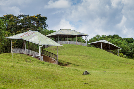san agustin: Protective roofs over statues located at Alto de los Idolos site near San Agustin, Colombia Stock Photo