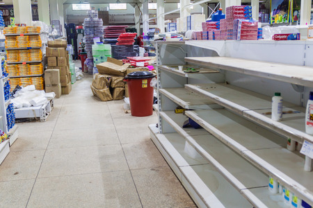 SANTA ELENA DE UAIREN, VENEZUELA - AUGUST 12, 2015: Empty shelves in a supermarket. Shortages of basic supplies are common in Venezuela.