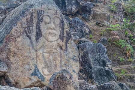san agustin: Figure carved in a rock located at El Chaquira site near San Agustin, Colombia Stock Photo