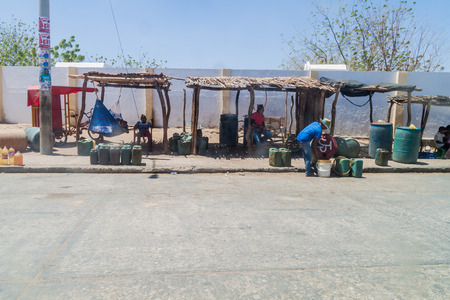 illegality: URIBIA, COLOMBIA - AUGUST 23, 2015: View of stalls selling cheap petrol in Uribia. This town is located near Venezuelan border, from where it is smuggled. Editorial