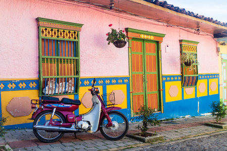 antioquia: GUATAPE, COLOMBIA - SEPTEMBER 2, 2015: Colorful decorated houses in Guatape village, Colombia Editorial