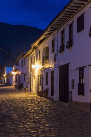cobbled: Evening moody view of a cobbled street in colonial town Villa de Leyva, Colombia. Stock Photo